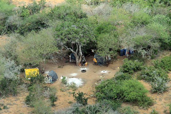 Temporary camps hidden under acacia scrub litter the landscape